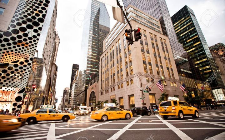 15849758-NEW-YORK-JULY-21-Yellow-taxis-rides-on-5th-Avenue-on-July-21-2012-in-New-York-USA-5th-Avenue-is-a-ce-Stock-Photo